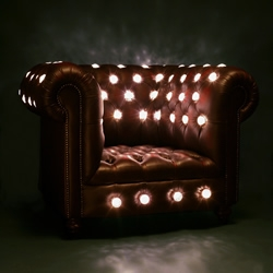 Lee Broom's Club Chair, a traditional Chesterfield spectacularly transformed with fairground jewel light bulbs, is one of his pieces being featured at this years London Design Festival.