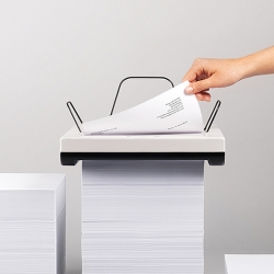 "Mugi Yamamoto's diploma project is a compact inkjet printer, which is placed on top of a paper pile. When printing, ""Stack"" slowly moves downwards and swallows the pile until no paper is left."
