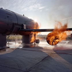 """Airside"" series, photographer Richard Mosse captures the disaster-response training practice of setting life-size model airplanes on fire. Mosse's pictures demonstrate that, in a post-9/11 world, an image of aircraft on fire, for any reason, can stoke fear."