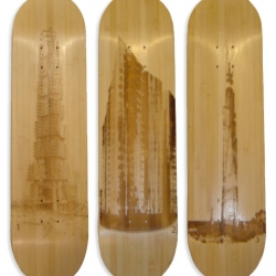 Piotr Woronkowicz has created a new set of  utopian architectural designs laser engraved onto bamboo skate decks with a matching grind box coffee table.  Better suited as wall coverings (trucks and wheels not included)
