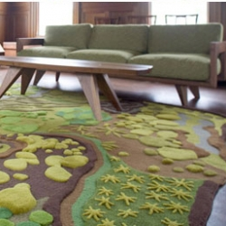 The Angela Adams collection has gorgeous rich-looking rugs that bring outside, in.