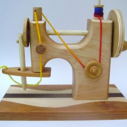children's wooden toy sewing machine by woodclinic is so cute. i would have loved this as a kid
