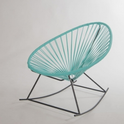 Mecedora Acapulco - a rocking chair variation of the 50's classic Acapulco chair.