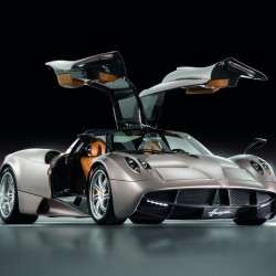 The stunning new Pagani Huayra features a 700hp 6.0-liter V12 engine from Mercedes AMG and can hit 230 mph. The interior is chock full of the company's signature look of carbon fiber and exposed aluminum.