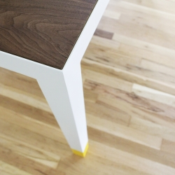 Modern steel table with rubber dipped feet by Synecdoche.