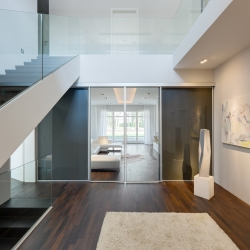 An old Villa in Potsdam, Berlin has been styled into a modern loft with a lot of stylish white. By Berlin Rodeo.
