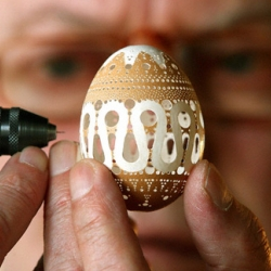Think you have the patience to drill 2,500 to 3,500 holes in an egg shell? Slovenian artist Franc Grom does and the results are amazing.