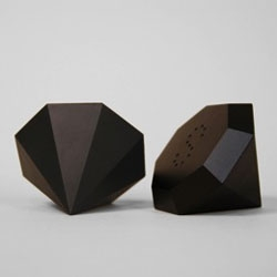 Carbon salt and pepper shakers by Gregory Buntain.