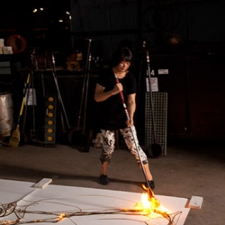 Etsuko Ichikawa's makes art by scorching paper with molten glass at 2100°F in this featured video from Anthropologie.