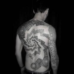 Stunning geometric precise tattoo designs from Tomas Tomas.