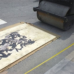 Winnipeg had their second annual Steamroller Print Festival, where local artists create large linoleum carvings which are then inked and printed on large canvases with the aid of a steamroller.