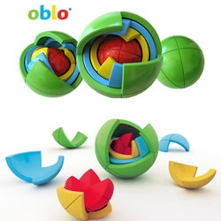 The OBLO by Marko Pavlovic is a 3D puzzle for kids composed of  spherical elements of various sizes, shapes and colors. The pieces must be twisted against a central axis in order to be disassembled or assembled. A Rubik's Cube for kids of sorts.