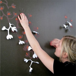 Hanna Nyman's 3-D wallpaper invites the user to peel off the outer layer to expose the design underneath.