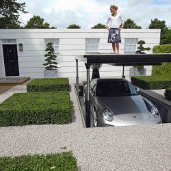 The Porsche Garden was part of the Royal Horticultural Society Show at Hampton Court back in July of 2008.  This stylish automobile storage system (or off-street parking solution) was part of Flemond Warland's garden design installation which won Gold.