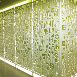 "This is our latest project. Wallscreen at UCSD The Loft.  Hand drawn fonts waterjet from 1/4"" aluminum. Powder coated white. Wallscreen is 60' long. Artwork does not repeat."