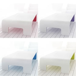 Stuart Melrose's Corian tables - I love the hint of color on the underside.