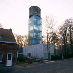 Jo Crepain designed this house outside of Antwerp around an old water tower that the client admired. The actual living space all happens in the cube below, but the levels surrounding the water tower are used for relaxing and viewing the landscape around the tower.