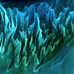 Above pic is of the ocean currents in the Bahamas that made a sand-and-seaweed sculpture n much the same way that winds create sand dunes in the Sahara. View NASA's best pics of earth gallery on the National Geographic site.