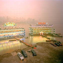 Gorgeous photos on Ferit Kuyas's website, particularly from the City of Ambition project, a documentation of the rise of the Chinese city Chongqiang.