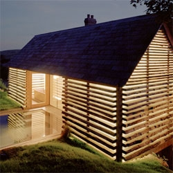 Charlotte Skene-Catling converted an old dairy into a five bedroom home with a bathing pool. I like the way the wood exterior references traditional barns but allows a tremendous amount of light into the house.