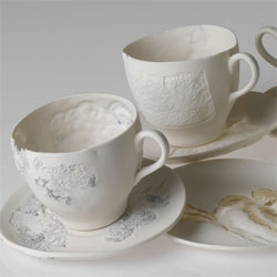 Beautiful porcelain tableware by Claire Coles - love the delicate, lace-like impressions.