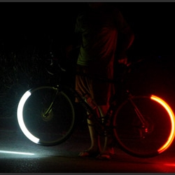 Designed not just look cool, the Revolight system turns your bike wheels into replacements for your headlight and tail light, illuminating the ground around you while alerting drivers to your presence.