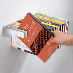 Satina Turner's Flybrary bookshelf - the books hang on metal strips to create the surface of the shelf.