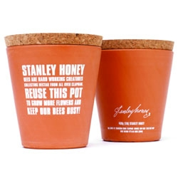Stanley Honey packages their honey in a reusable clay flower pot - asking you to keep their bees busy.