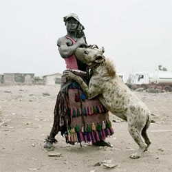 "Pieter Hugo's ""The Hyena & Other Men"" - a series of portraits of a band of Nigerian men and their domesticated hyena."