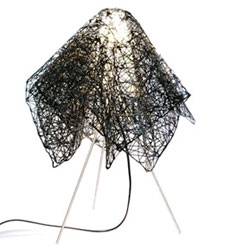 Also by Perfectos Dragones - the Velador Table Lamp - looks like a metal cloth draped over a bulb.
