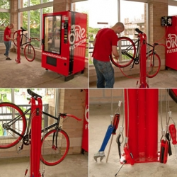 Bike Fixtation is a self-service bicycle repair station that includes compressed air, a vending machine for drinks and bike parts, and a work stand with common tools tethered to it.