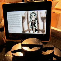Hockey pucks turned into iPad stands by Donald Corey