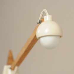 Elegant porcelain and cherry task lamp design by Owen Read.