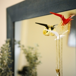Birdy is half a bird and half a hanger. When you attach her to your mirror the magic happens- she spreads her wings and becomes an elegant hanger.