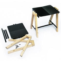 This flat pack stool is light, easy to assemble and transport. The distinctive characteristic of the '1-2-3 sit' stool is the dovetail joint with combined folded steel and oak wood.