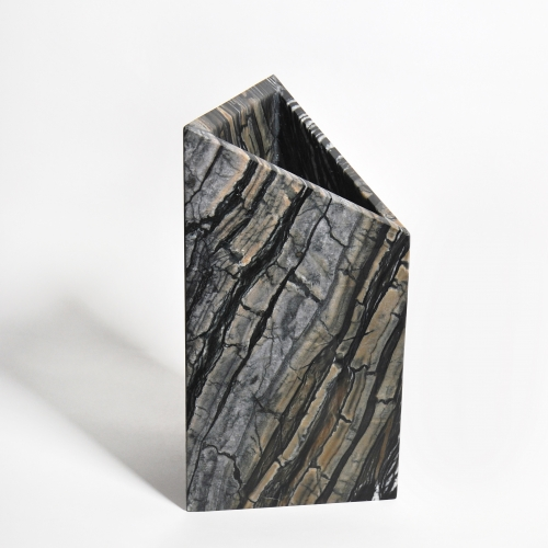 Triad is a handmade geometric vase constructed from Black Kenya marble tile by designer Phillip Jividen.