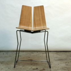 Check is a sleek and sophisticated chair created by designer James Lear.  Utilizing bent laminated bamboo ply with a stainless steel base, it's beautiful and eco friendly.