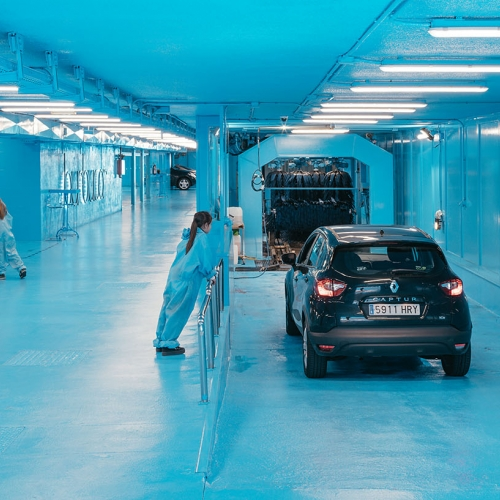 "Architect Lina Toro has transformed an existing car wash named ""Burbucar"" to reveal the cleaning processes to its customers in Madrid."