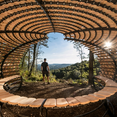 Perspectives by British designer Giles Miller is an organic pavilion structure covered with Cedar Shingles, which sits atop the beautiful Surrey Hills at Winterfold, and throws itself evocatively into the vista that has been opened up below.