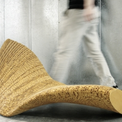 A lounge object made out of honeycomb cardboard. Dozens of layers together forming a 'Flow'.