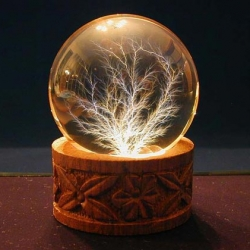 Lichtenberg Figures are fractal-like branching patterns that have been permanently captured within crystal clear acrylic.