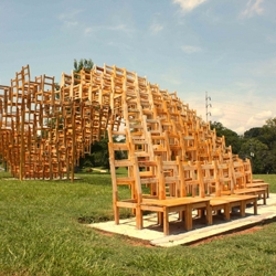 Composed of approximately 400 simple wooden chairs arrayed and stacked in a sine wave surface, the 'SEAT' public pavilion, by E/B Office, is a recently completed winning entry for this year's Flux Project in Freedom Park.