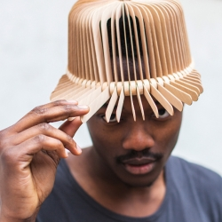 Tête De Bois design wooden headwear by Andra Deppieri