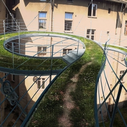 Polish Zalewski Architecture Group designed a walk-on balcony suspended in the middle of a dark courtyard in Gliwice, Poland.