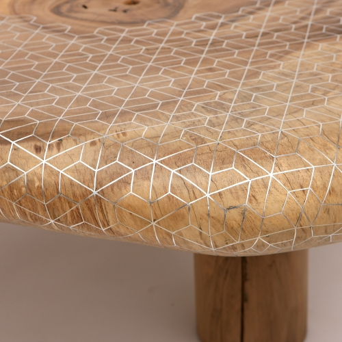 One-off table designed by Beirut-based studio Nada Debs - geometric patterns in tin inlay on solid organically-shaped acacia wood.