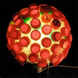 Lula Dot's CAPtivate lamp recycles old bottles and their caps to make this beautiful fixture.