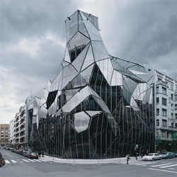 um...craziness! Coll-Barreu Arquitectos' Basque Health Department Headquarters in Bilbao. Turns out that crazy facade is really just a skin over a much more regular building - check out the night photos to see.