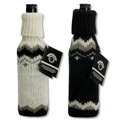 Halla Helgadottir's Brennivins-sock. Brennivin, the original Icelandic Schnapps and the unique Icelandic woolen sweater have kept Icelanders warm and lucid for decades. Here is a woolen sock designed to keep the Icelandic schnapps Brennivin cold or hot.