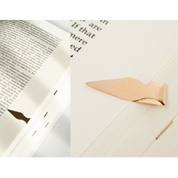 Book Darts are paper-thin metal clips that bookmark not only your page but your specific place in the book. [Editor's Note - i totally had these as a little kid - long, long time ago!]