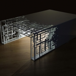 """""""Cubical"""" coffee table by Frederic Brunet and Ludovic Fraysse, french designers from Coco & Co design. A pull-out low table made of finely cut and perforated steel."""